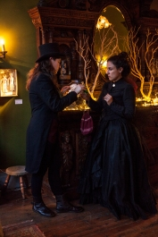 Doctor Vitae (Julie Douglas) offers a helpful tonic to Josephine (Maria A. Leigh) in ELIXIR OF LIFE.