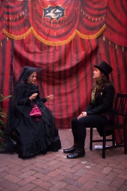 Josephine (Maria A. Leigh) consults with Doctor Vitae (Julie Douglas) in ELIXIR OF LIFE.