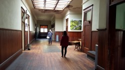 Testing the acoustics in the Schoolhouse's main lobby