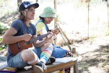 Charlotte (Joan Howard) and Isla (Julie Douglas) play ukuleles in PORT STORIES. Photo by Serena Morelli.
